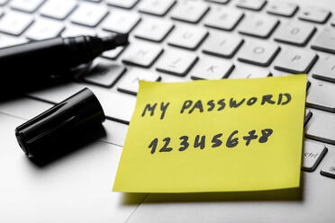 sticky-note-with-weak-easy-password-on-laptop-keyboard-898320664_2125x1416